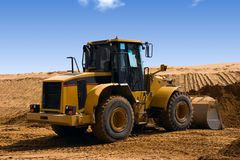 Yellow Bulldozer at Construction irrigation canal Stock Photography
