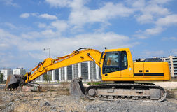 Yellow bulldozer at a construction site Stock Image