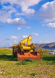 Yellow bulldozer on the grass in the countryside Stock Images