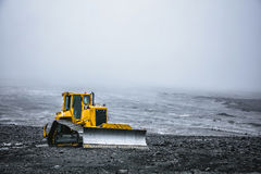 Yellow bulldozer in Iceland. Summer 2016 Royalty Free Stock Photography