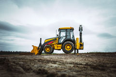 Yellow bulldozer overcome barrier. Dirty Yellow bulldozer in wide angle, powerfull Stock Photos