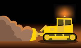 Yellow bulldozer pushing dirt Stock Photo