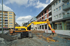 Yellow bulldozer on site in the city Stock Images