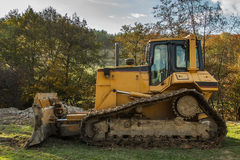 Yellow bulldozer Stock Images
