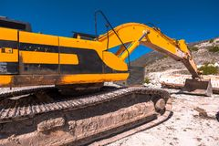Yellow bulldozer on tracks at the mine. On a sunny day royalty free stock photo