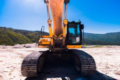 Yellow bulldozer on tracks at the mine. On a sunny day stock photo