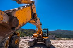 Yellow bulldozer on tracks at the mine. On a sunny day stock photography