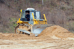A yellow bulldozer working Stock Image