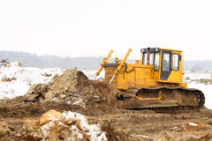 A yellow bulldozer working in the winter Stock Photography