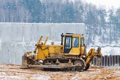 Yellow bulldozer working in the winter Royalty Free Stock Images