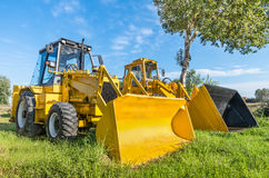Yellow Bulldozers in the Nature Stock Photos