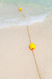 Yellow buoy on the beach Royalty Free Stock Photography
