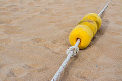Yellow buoy on the beach Stock Images