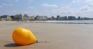 Yellow buoy on the beach stock video footage