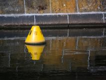 Yellow Buoy Floating In A Canal In Berlin Royalty Free Stock Photos