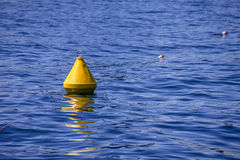 Yellow buoy. A yellow buoy floating on a wonderful blue sea royalty free stock images