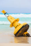 Yellow buoy on mexican beach Stock Image