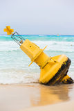 Yellow buoy on mexican beach Royalty Free Stock Photos