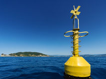 Yellow buoy on the ocean Royalty Free Stock Images