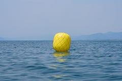 Yellow buoy for regatta Royalty Free Stock Photography