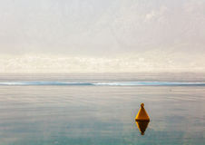 The yellow buoy in the sea Stock Photo