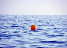 Yellow buoy on sea water Stock Photos