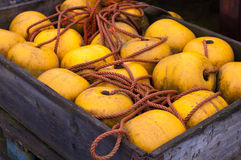 Yellow buoy in a wooden crate. Yellow buoy and rope in a wooden crate Royalty Free Stock Photo