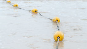 Yellow Buoys on the beach Royalty Free Stock Images