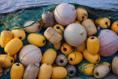 Yellow buoys and fishing nets Royalty Free Stock Photography