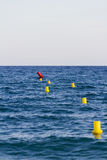 Yellow buoys in the sea Stock Image