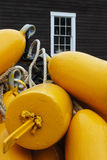 Yellow Buoys. Stack of yellow buoys in front of a lobster shack Royalty Free Stock Photos