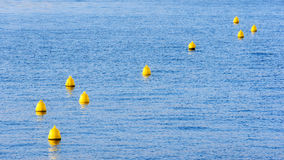 Yellow buoys on water Royalty Free Stock Images