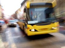 Yellow bus. Color photo of a yellow bus on a city street royalty free stock photos