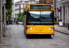 Yellow bus. On europe city street Royalty Free Stock Image