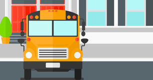 Yellow bus on the background of school building. Royalty Free Stock Images