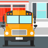 Yellow bus on the background of school building. Royalty Free Stock Photography