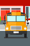 Yellow bus on the background of school building. Royalty Free Stock Photo