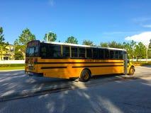 Yellow bus and blue sky Stock Photos