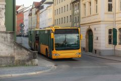 A yellow bus in the city. Center of Regensburg royalty free stock photos