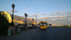 Yellow bus on the embankment of Riga with the famous local market royalty free stock photos
