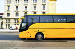 Yellow bus for tourists transporation in Prague ci Royalty Free Stock Images