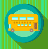 Yellow bus on green striped background Stock Photo
