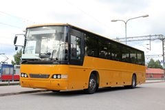Yellow Bus at Railway Station Royalty Free Stock Images