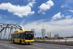 Yellow Bus on The Road with Beautiful Sky royalty free stock photos