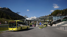 Yellow bus in St. Anton. Regio Bus Arlberg - station in Sankt Anton - Tirol Austria Royalty Free Stock Photos