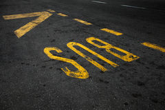 Yellow bus stop marking Royalty Free Stock Image