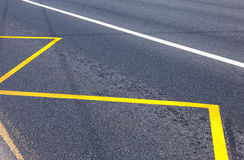 Yellow Bus Stop sign painted on the asphalt Stock Photos