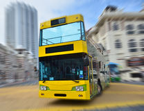 A yellow bus on the street corner Stock Photography