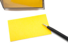 Yellow Business (blank) card on White with pen Stock Photo