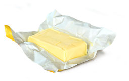 Yellow butter with paper package Stock Image